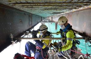 Rope access for non-destructive testing of structure.